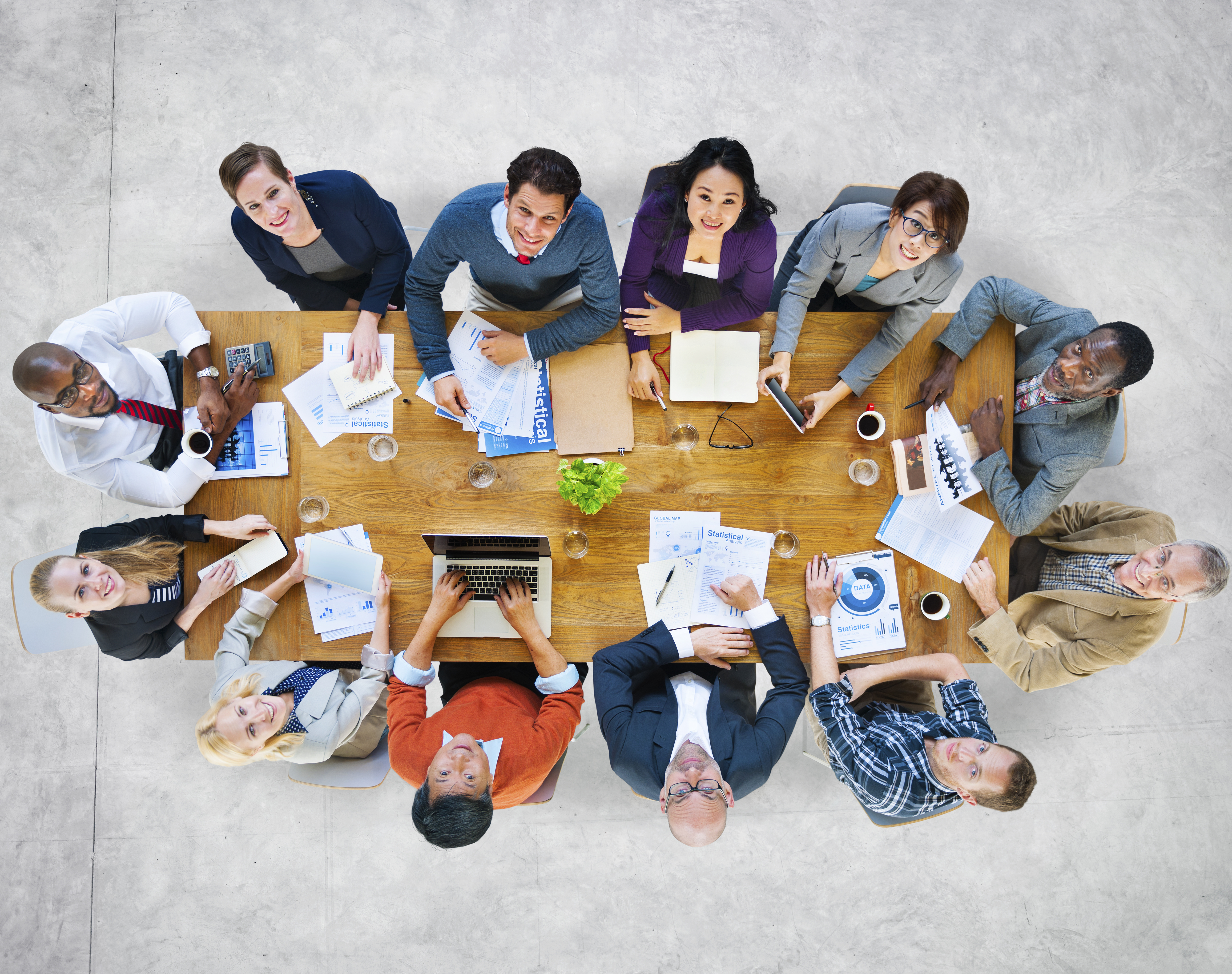 Multi-Ethnic Group of People in a Meeting Looking Up